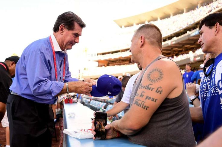 October 24, 2017:  The stars came out to watch the Dodgers beat the Astros during the first game of the World Series.  Former Los Angeles Dodgers player Steve Garvey signs autographs for fans before game one of the 2017 World Series between the Houston Astros and the Los Angeles Dodgers at Dodger Stadium on October 24, 2017 in Los Angeles, California. Photo: Harry How/Getty Images
