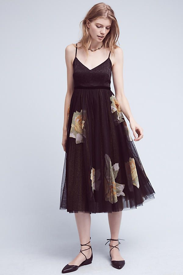 Saffron Tulle Dress, Black. A charming tulle dress with a vintage-inspired floral print. Go minimal with black heels and a classic clutch, or layer on the glamour with bold jewels and sparkly heels.