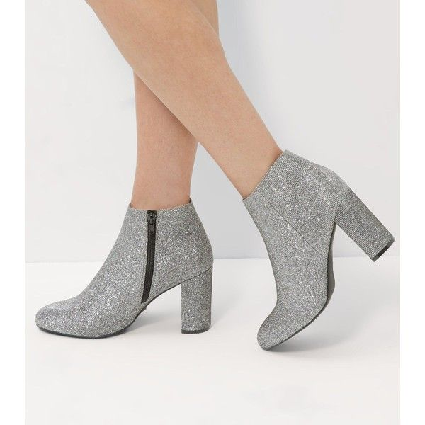 New Look Wide Fit Silver Glitter Block Heel Ankle Boots (£30) ❤ liked on Polyvore featuring shoes, boots, ankle booties, pewter, high heel booties, silver boots, silver ankle boots, pointy-toe ankle boots and bootie boots