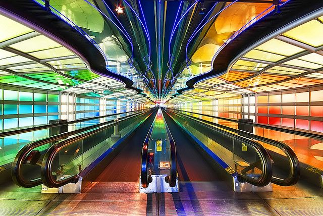"""Neon Light Show - United Airlines Terminal (2) - Chicago O'Hare International Airport  """"Sky's The Limit"""" created 1987 by Michael Hayden.  You can find him at http://www.thinkinglightly.com/intro.html      I've done a photo shoot here before, best way to kill time on a layover.  I could ride back and forth for several hours and still be mesmerized."""