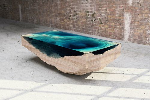 The Abyss Table is a stunning coffee table that mimics the depths of the ocean with stacked layers of wood and glass. Made by London-based furniture design company Duffy London.