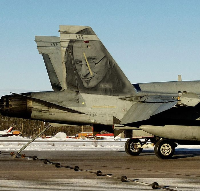 ver the years, there have been many celebrities who have gone for a flight in a CF-18. Canadian rock legend, Geddy Lee of the group Rush, whose soaring and astoundingly high tenor voice carries RUSH to the stratosphere, went for a ride in 2001. The band's next album, Vapor Trails, and the song Ceiling Unlimited was the result of Lee's experience. Here, the Geddy Lee Hornet catches the wire at Inuvik, Northwest Territories. CF Photo by Corporal Jean-François Lauzé