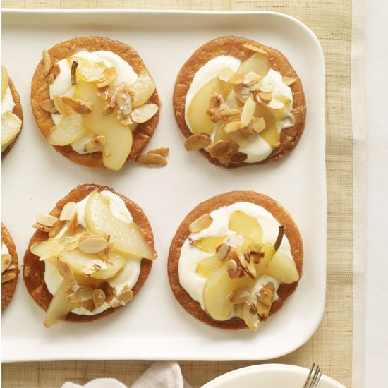 Puff Pastry Pear Tartlets | The baked pastry rounds can be stored in an airtight container overnight. The caramelized pears can be refrigerated overnight. Rewarm before serving.