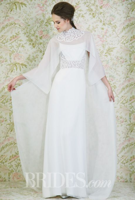 Brides.com: Spring 2015 Wedding Dress Trends. Trend: Capes. Style N110011, strapless sheath wedding dress with an embroidered center and matching cape, Angel Sanchez