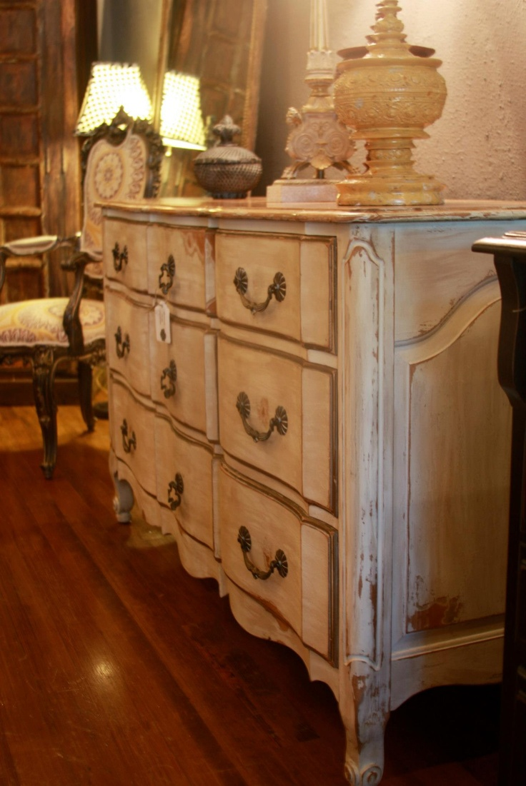 A solid wood dresser we refinished in a luxurious cream antique french finish!