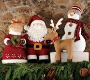plush santa, mrs. claus, reindeer, and snowman figurines