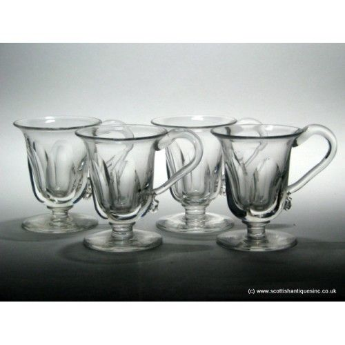 Set of Four Victorian Custard Cup Glasses c1890   A fine set of four Victorian Custard Cups c c1890.  They all have flared round funnel bowls with slice cutting to the sides, applied handles, and plain feet.  Let your culinary imagination run wild with ways in which they may be returned to use, try punch !  English lead, no chips cracks or restoration, they measure 3 inches tall with 2 ½ inch bowls.