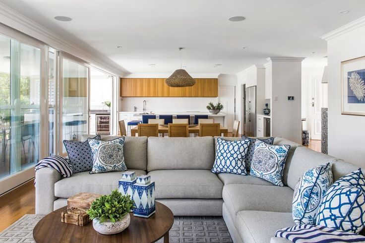 Queensland Homes Blog....love the styling of items on coffee table and colors in this family room/den. Navy blues linen taupe, perfect beach house Hampton style