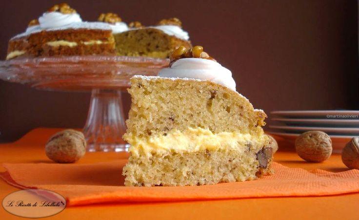 Ricetta per realizzare una soffice e golosa Torta alle noci farcita con della buttercream e panna montata.