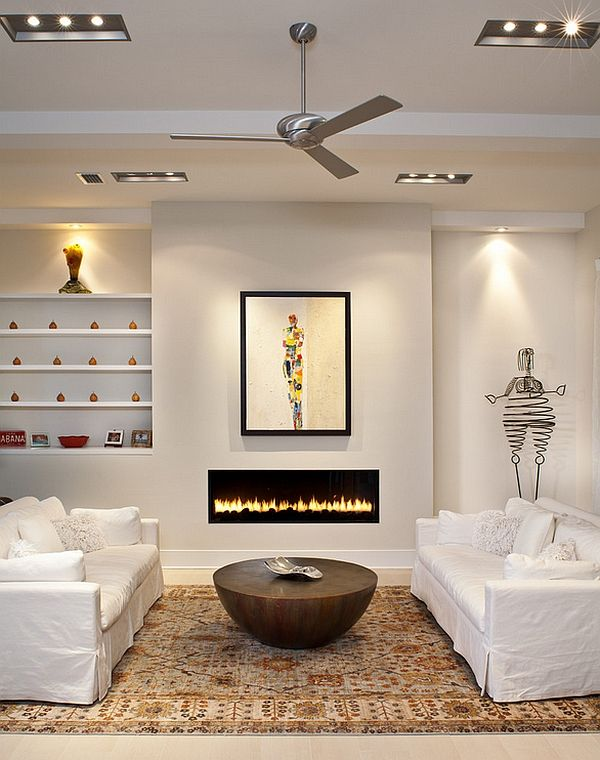 Unusual coffee table coupled with a sleek fireplace - Decoist