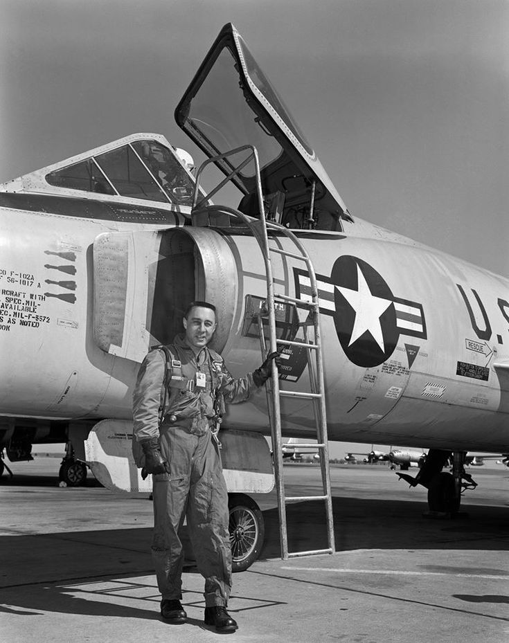 Full Afterburner — Gus Grissom next to an F102. Gus
