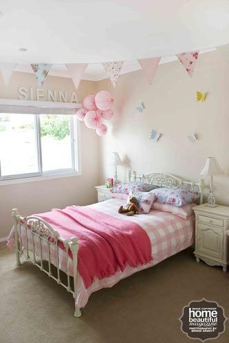 This little girl's room is perfectly pink, with just a touch of blue appearing in the handmade bunting and cushions, in Cath Kidston fabric from the Sammy Jo range, and paper butterflies from Adairs. The bedside tables and lamps are from Everyday Living and the Martha Stewart paper lanterns are from Spotlight.