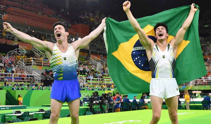 60684400_topshot_-_brazil27s_arthur_mariano_r_and_brazil27s_diego_hypolito_celebrate_after_the_men27s_f.jpg (5568×3288)