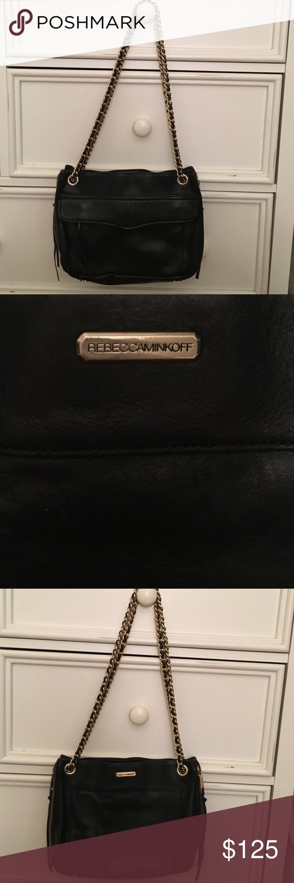 Authentic Rebecca Minkoff black purse. Black Rebecca Minkoff leather swing convertible crossbody bag with gold zippers and chain. Can be worn over the shoulder or cross body. Has many zippers and space inside for wallets etc. Rebecca Minkoff Bags Shoulder Bags