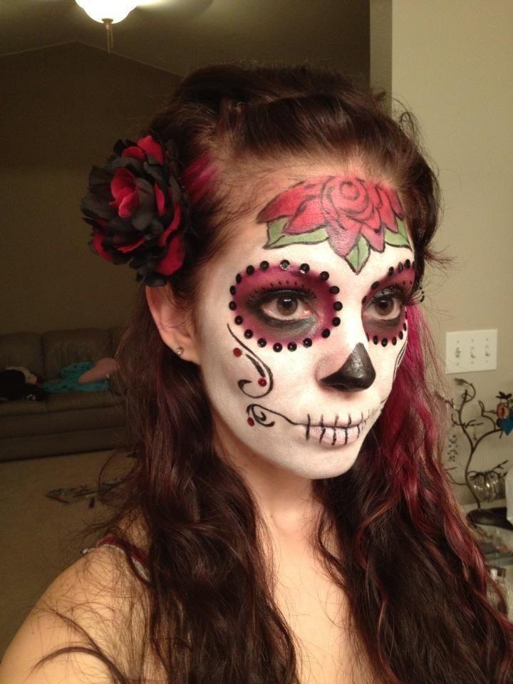 Sugar skull makeup. Good use of sequins on cheeks. Nice rose too.