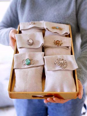 sachet bags sewn from linen, filled with lavender & secured with vintage brooches for a hostess gift.