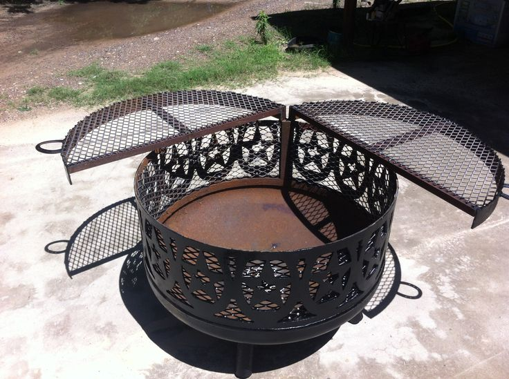 Ladybug firepit. Original welding project with horseshoes. Built out of an old water tank. Cooking grates come off so it can be used as a firepit.