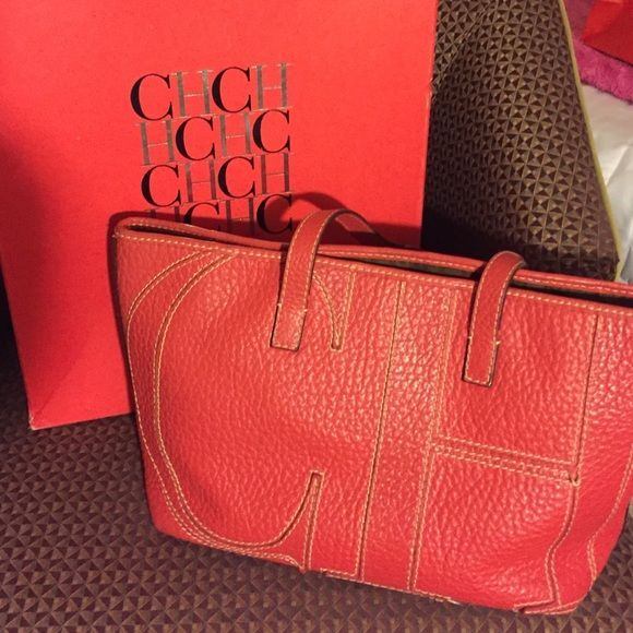 Carolina Herrera Handbag Red Carolina Herrera handbag in super good conditions!!  Need the money for surgery please help  Carolina Herrera Bags Totes
