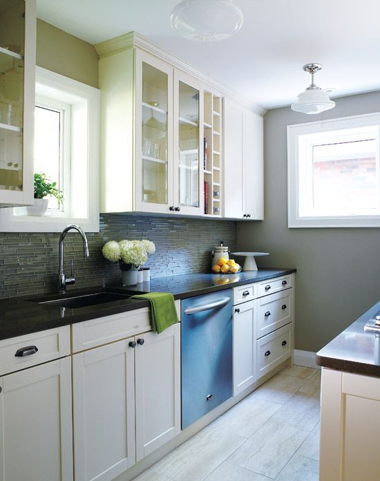 I like the different top cabinets and the lower drawers for Compact galley kitchen designs