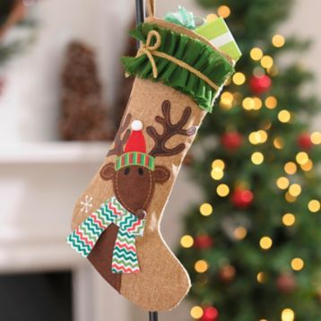 Have some fun with your stockings this Christmas! We love the Burlap Ruffle Reindeer Christmas Stocking. #Kirklands #CozyChristmas #holidaydecor