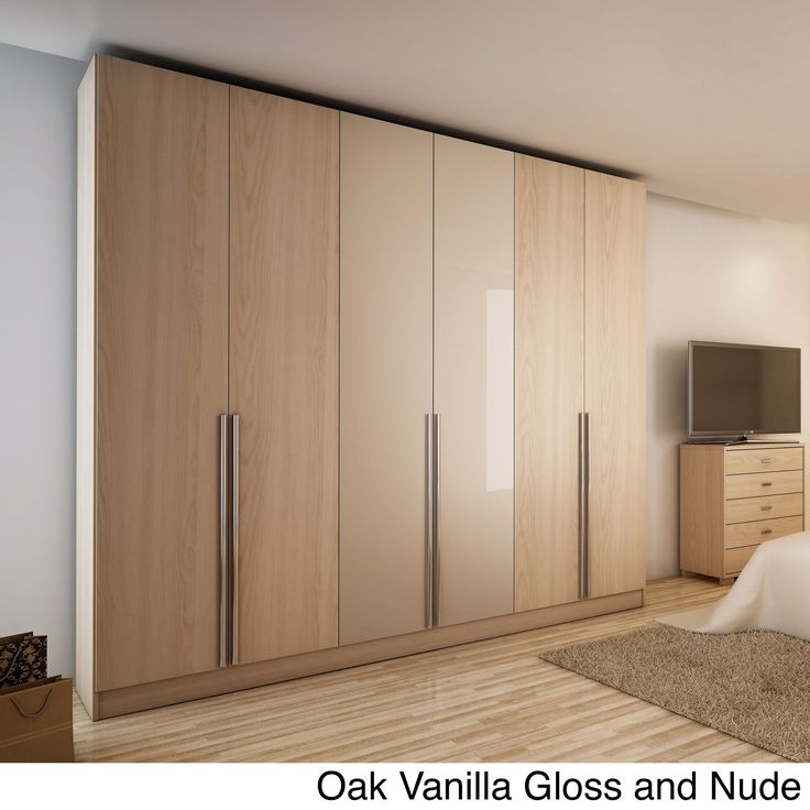 Add extra storage space with the Manhattan Comfort 'Downtown' 6-door wardrobe. This contemporary wardrobe interior features three top shelves, two bottom shelves, four cubbies, four drawers and three