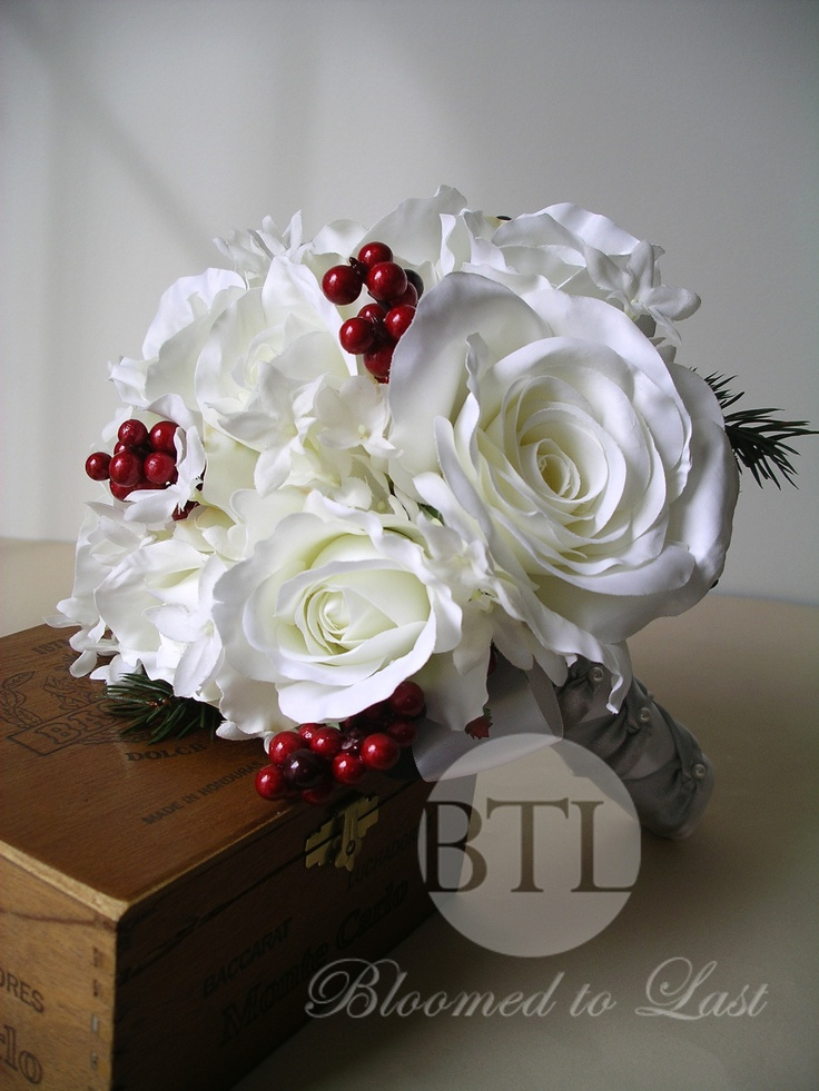 A recent #Christmas #wedding bouquet for a client. Love the silver ballet tie on the handle. http://www.bloomedtolast.com/page/8/custom-silk-wedding-flowers-decor
