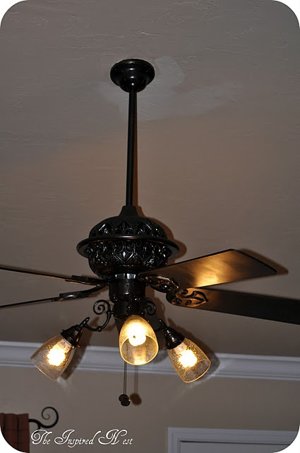 DIY ceiling fan makeover, spray paint and new globes, that's it!
