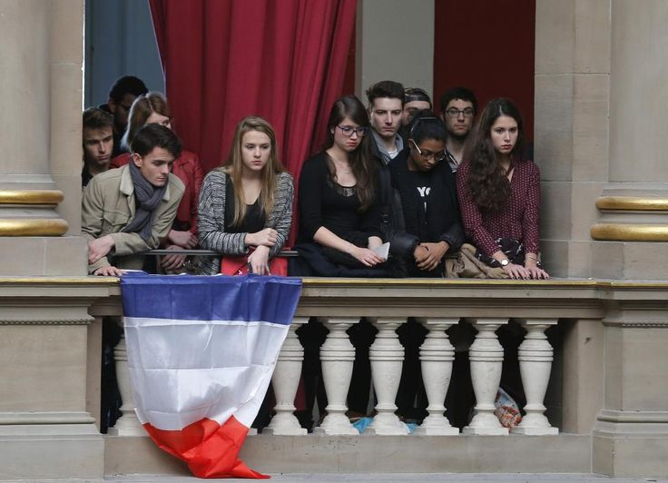 """Students of Strasbourg University observe a minute of silence at the """"Palais Universitaire"""" in Strasbourg, France to pay tribute to victims of Friday's Paris attacks, France, November 16, 2015. REUTERS/Vincent Kessler"""