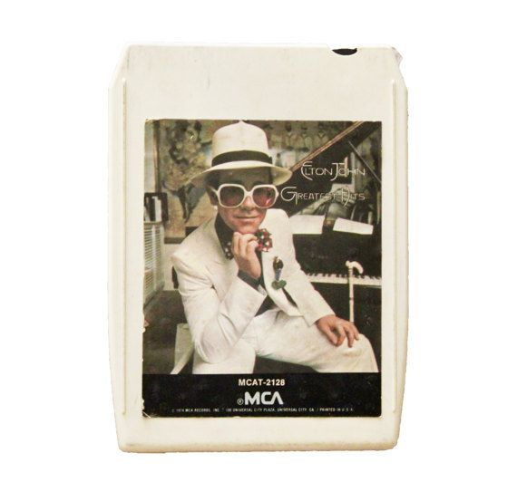 Vintage 70s 8 Track Elton John Tape Cartridge This tape includes some of my absolute favorites from Elton John. See the song list below...  Greatest Hits 8 Track Tape Stereo Tape Cartridge MCA - 1974  #1 Your Song Bennie and the Jets Border Song  #2 Saturday Nights Alright for Fighting Rocket Man (I Think Its Going to be a Long Time for Me) Bennie and the Jets  #3 Honky Cat Border Song Crocodile Rock  #4 Daniel Goodbyey Yellow Brick Road Dont Let the Sun Go Down on Me  Please note: I do not…