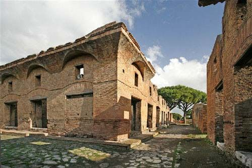 Street known as 'via dei Balconi' in Ostia Antica, harbor city of ancient Rome showing 'insulae' (apartment buildings) photo by Charles Gardner