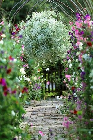 Sweetpea walkway - http://www.sarahraven.com/how-to/floristry-and-crafts/7/how-make-hanging-flower-globe