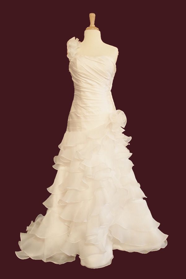If only i could have a wedding every 5 years...One-Shoulder ruffled Organza Wedding Dress (i know someone who would might like this)