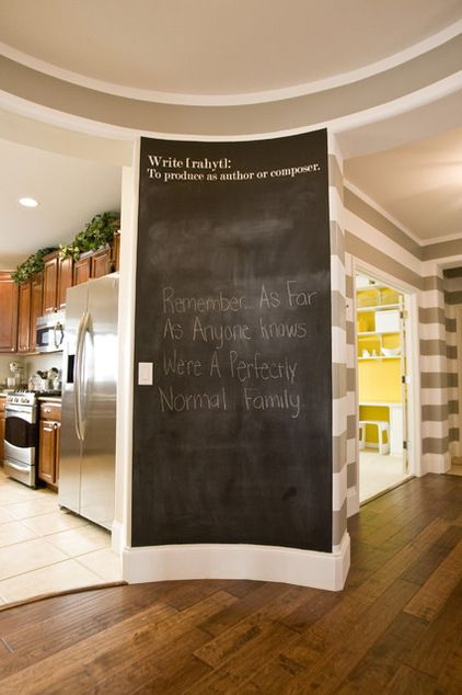 Modern entry by Michelle Hinckley. One wall of the entryway is covered in chalkboard paint — the perfect spot to jot down a quick note or write a favorite quote.