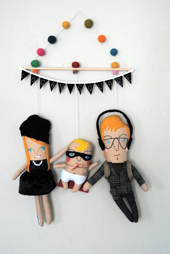 PinkCheek Studios makes custom mobiles that capture your one-of-a-kind family for all posterity. So fun!