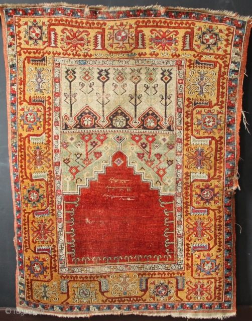 Dated Ladik prayer rug with golden yellow Inice border. As found, needs a clean and small amounts of repair. Has fuchsine and Indigo dye sulphonic but nevertheless is a very handsome rug.  ...