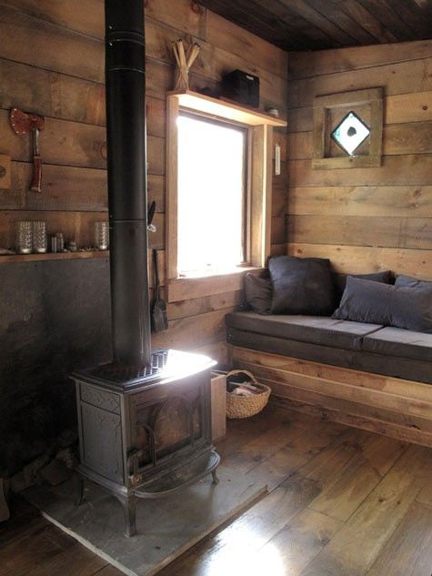 Interior lap rough hewn siding.  Buck stove.  Built in chaise/twin bed.