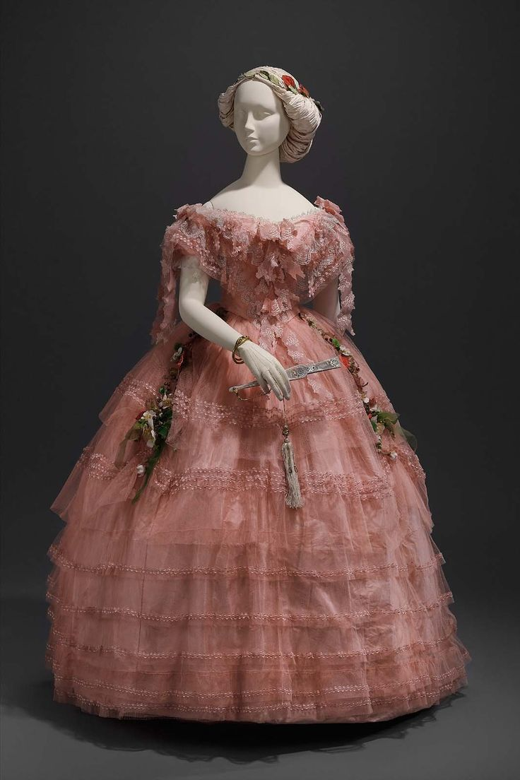 Ball dress, about 1858, accession number 51.1346a-b, silk plain weave (taffeta), machine net (tulle) and silk bobbin lace; trimmed with silk ribbon, embroidered silk net, and silk flowers, Museum of Fine Arts, Boston.