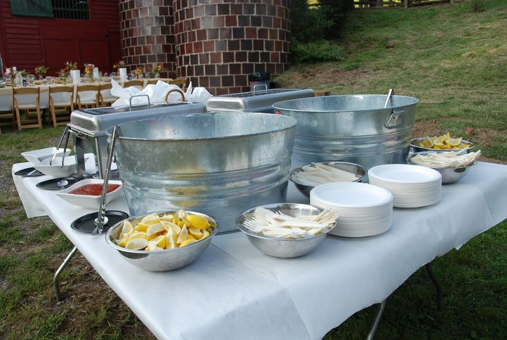 Put the low country boil in the metal tubs and have the difference sauces around, also serve glass bottled cokes, etc!