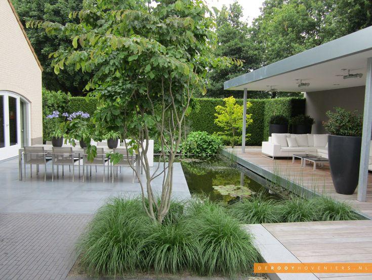 Tuin idee De Rooy Hoveniers strakke tuin overkapping vijver terras Waalwijk