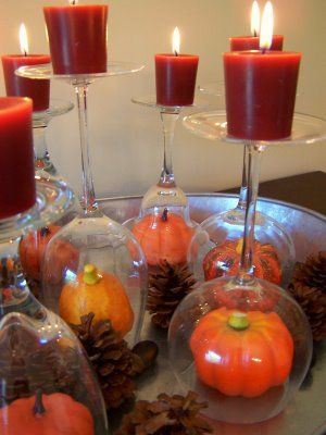 turn over wine glass for centerpiece Another Diamond candle jar reuse idea. Use fall decor like fake leaves, apples, corn, pumpkins and put in jar upside down. Put lid on, flip over, add candle, and light! #diamondcandles #harvestcontest2012