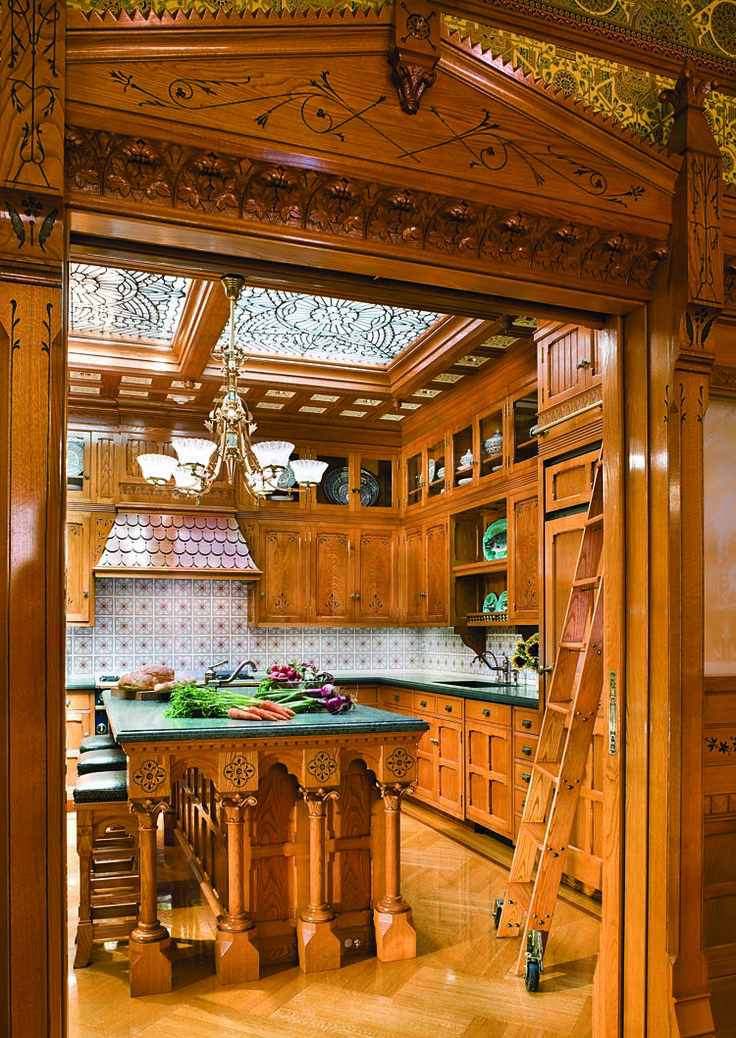 Adjacent to the family room, the kitchen continues the Modern Gothic theme, this time with chestnut cabinetry designed by the Parker firm. The space is flooded with natural light from an antique four-panel textured-glass skylight.