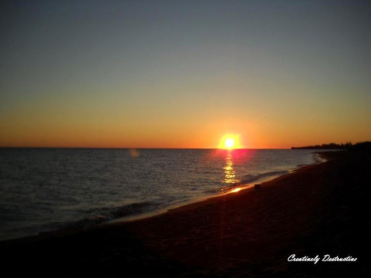 Sunrise at 4:30AM on Sandy Beach, Cap Pele, NB. Rachel McAdam. Nikon Coolpix.