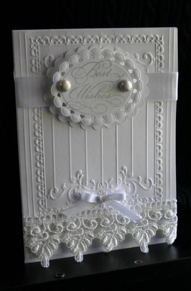 IC290  Elegant greetings wedding card sizzix folder, embossed and then added the lines with my scorpal. Stamped the sentiment and cut it with a nestie, put ribbon behind it and added some brads. Put the lace on the bottom and added the bow.