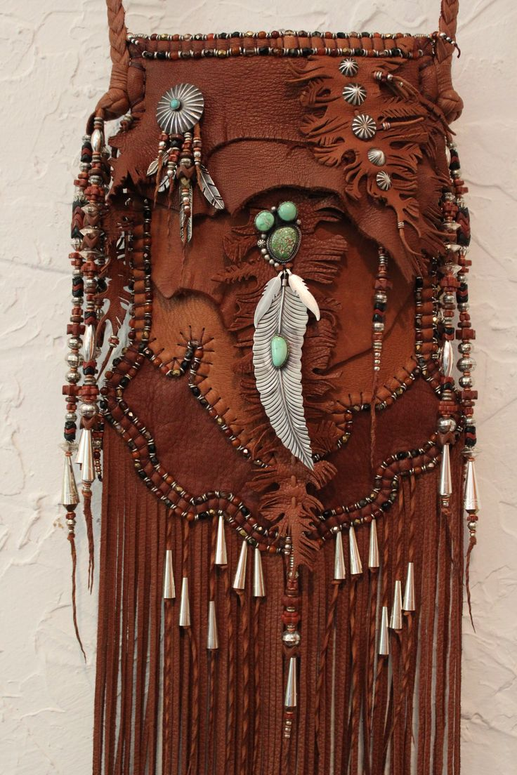 Feather and Fringes bag. Made by Carole Hook - Portobello Rd. London - via @Christin Miller | Maverick Style - #CowgirlChic