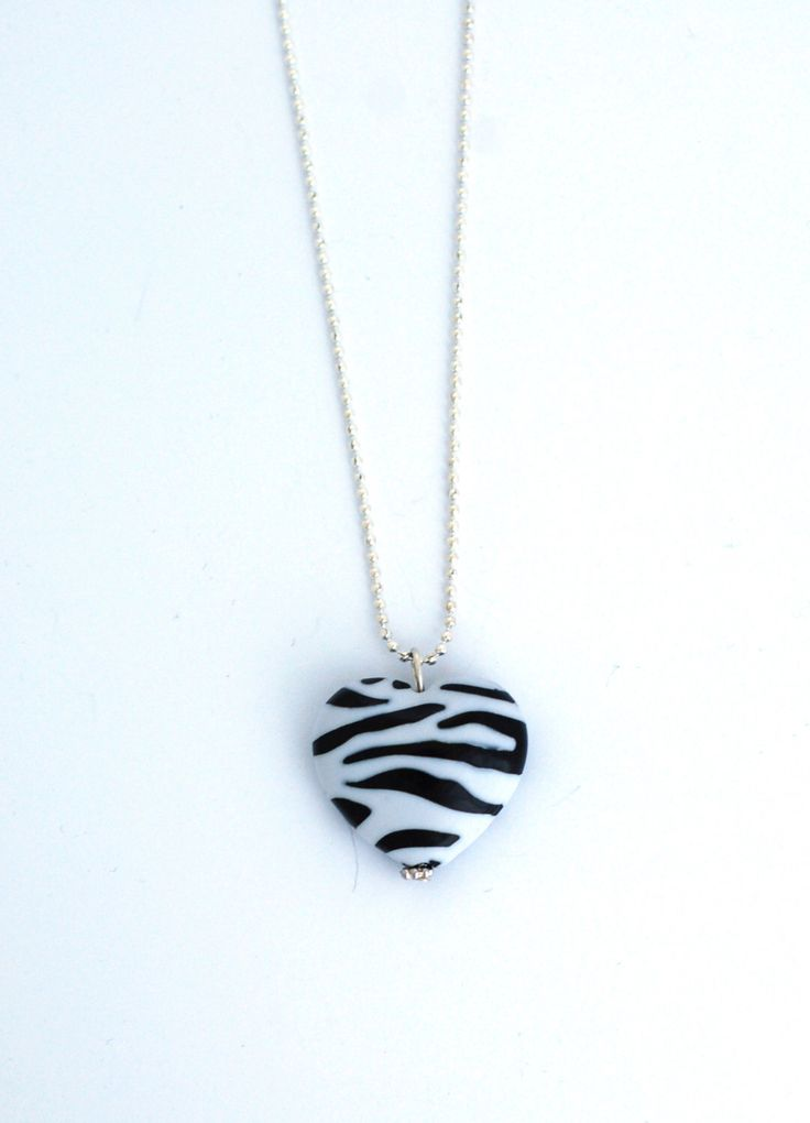 A personal favorite from my Etsy shop https://www.etsy.com/se-en/listing/235766775/zebra-heart-necklace-animal-necklace