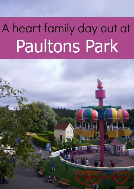 "Looking across at Peppa's Big Balloon Ride in Peppa Pig World with the text ""A…"