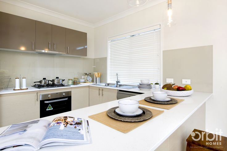 An ultra modern and sleek kitchen design, with bench for morning breakfasts