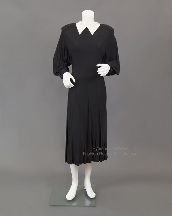 Black jersey dress with dropped shoulder, white satin collar, godet skirt Label: Jean Muir, Creeds FRC2009.01.395