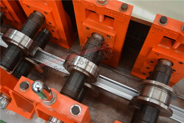Here are the #steel #C #stud #roll #forming #machine #with #embossing, 11 rollers tation, 40 mm diameter shaft, Cr12 roller material, hydraulic cutting.  All the roller and cutter adopt Cr12 steel with quenched treatment to make sure the the roller more stronger and no scratch the surface of produce, and the cutter more harder and long lived.