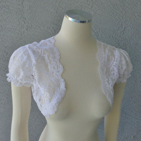 This one matches the lace of my dress pretty well (Wedding Bridal Party White Or Ivory Scalloped by Chuletindesigns, $60.00)